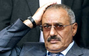 Yemeni President Ali Abdullah Saleh reacts while looking at his supporters, not pictured, during a rally supporting him, in Sanaa,Yemen, Friday, April 8, 2011. Tens of thousands of Yemenis have converged in the capital for rival demonstrations _ with some demanding the president's ouster and others showing their support. Police and army units were deployed Friday to prevent any friction between the two sides. (AP Photo/Muhammed Muheisen)